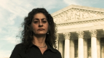 Jessica Lenahan stands outside Supreme Court in Washington, DC