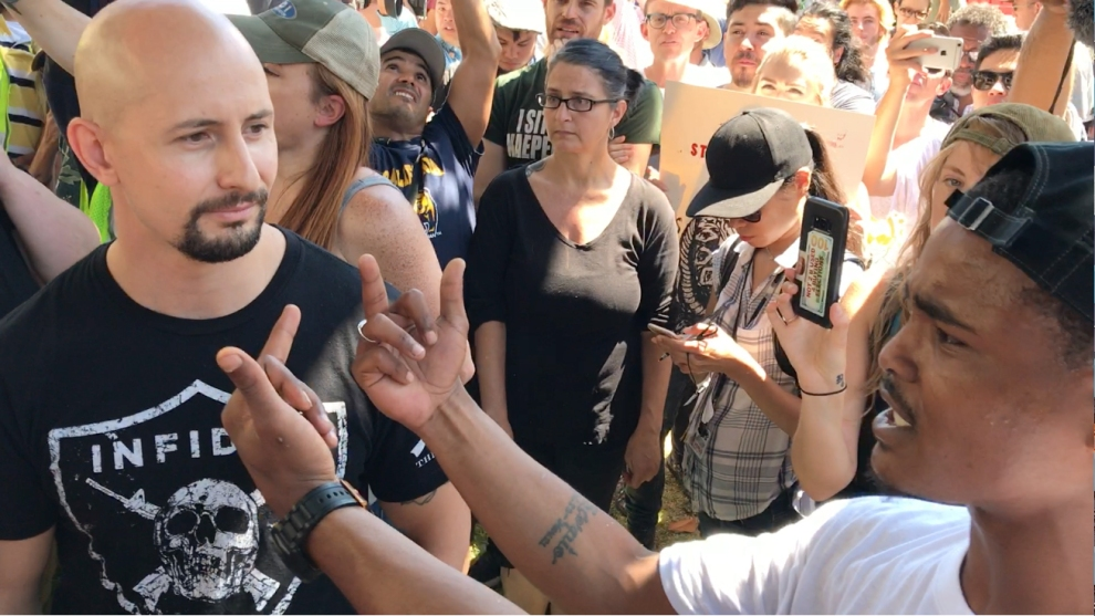 Johnny Benitez argues with counterprotesters in Berkeley on Sunday.