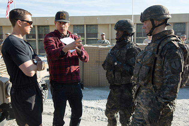 Writer/director Jason Hall preps his actors for a battle scene.