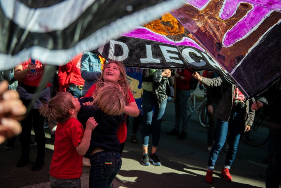 Children played under parachutes as the march made its way along Broadway.