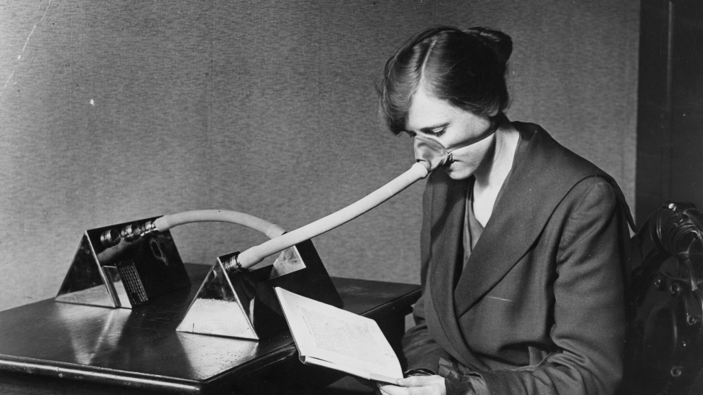27th February 1919: A woman wearing a flu mask during the flu epidemic.