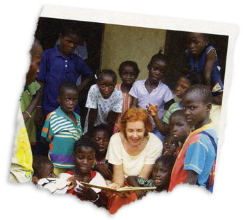 A woman reading to orphan kids
