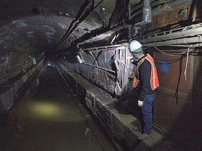 An MTA employee in a flooded tunnel