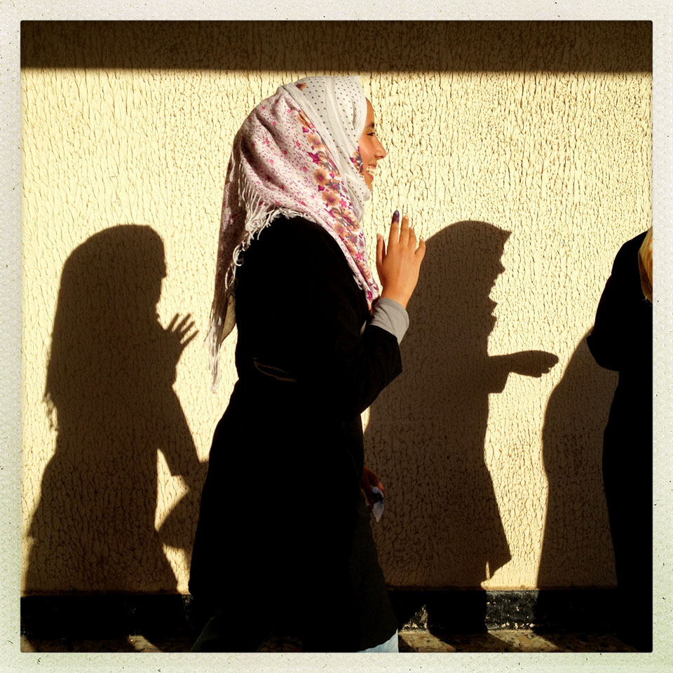 Women wait in line to vote in the first free Libyan elections in decades in Benghazi, Libya.