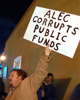 Protester at an anti-ALEC protest organized by Occupy Santa Fe in January.: suenosdeuomi/Flickr